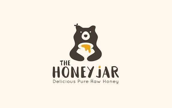 Logo mascotte ours miel